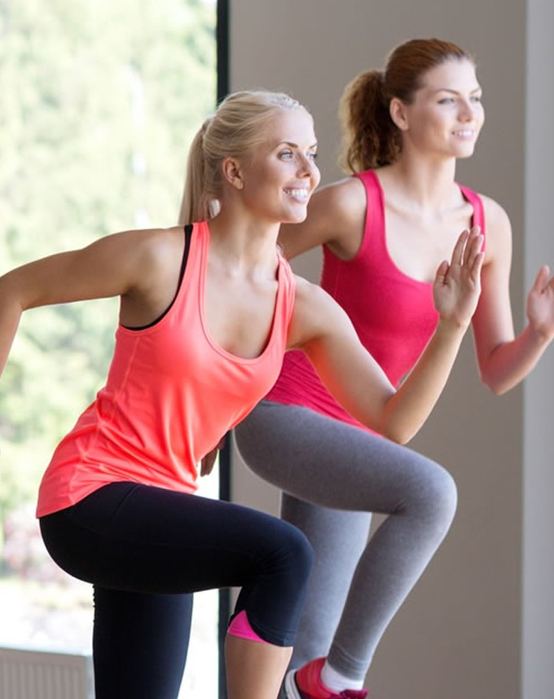 2 ladies doing aerobics