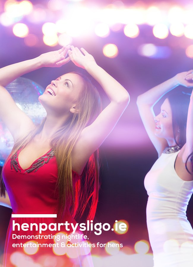 Girl in red dress & girl in white dress dancing with hands in air