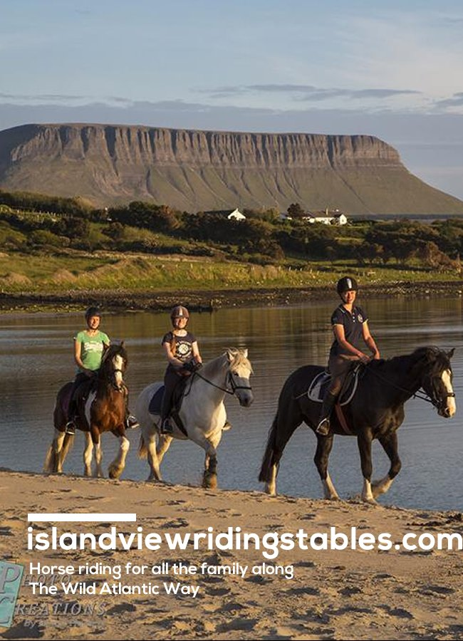 Horses from Island View Riding Stables on beach with Benbulben in background