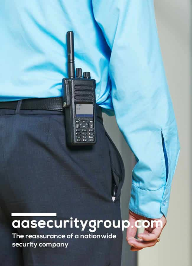 The back of a security guard with walkie talkie in pocket