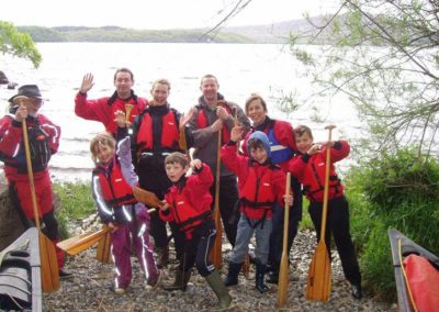 Children and partents posing for photo after kayaking