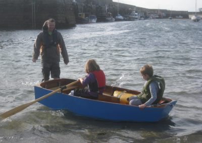 Jon Lomax instructing children in rowing boat Mullaghmore
