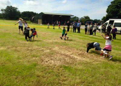Children doing 3 legged race in Ballintrillick